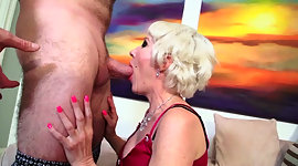Horny granny with hard makeup is on..