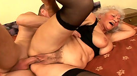 Busty granny in nylon hosiery riding..