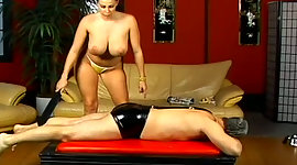 Boobalicious domme whips poor slave..