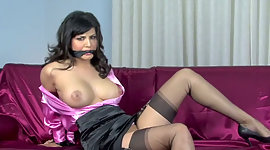 Tightened up and gagged dark-haired..