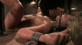 Restrained busty chick with ball gag..